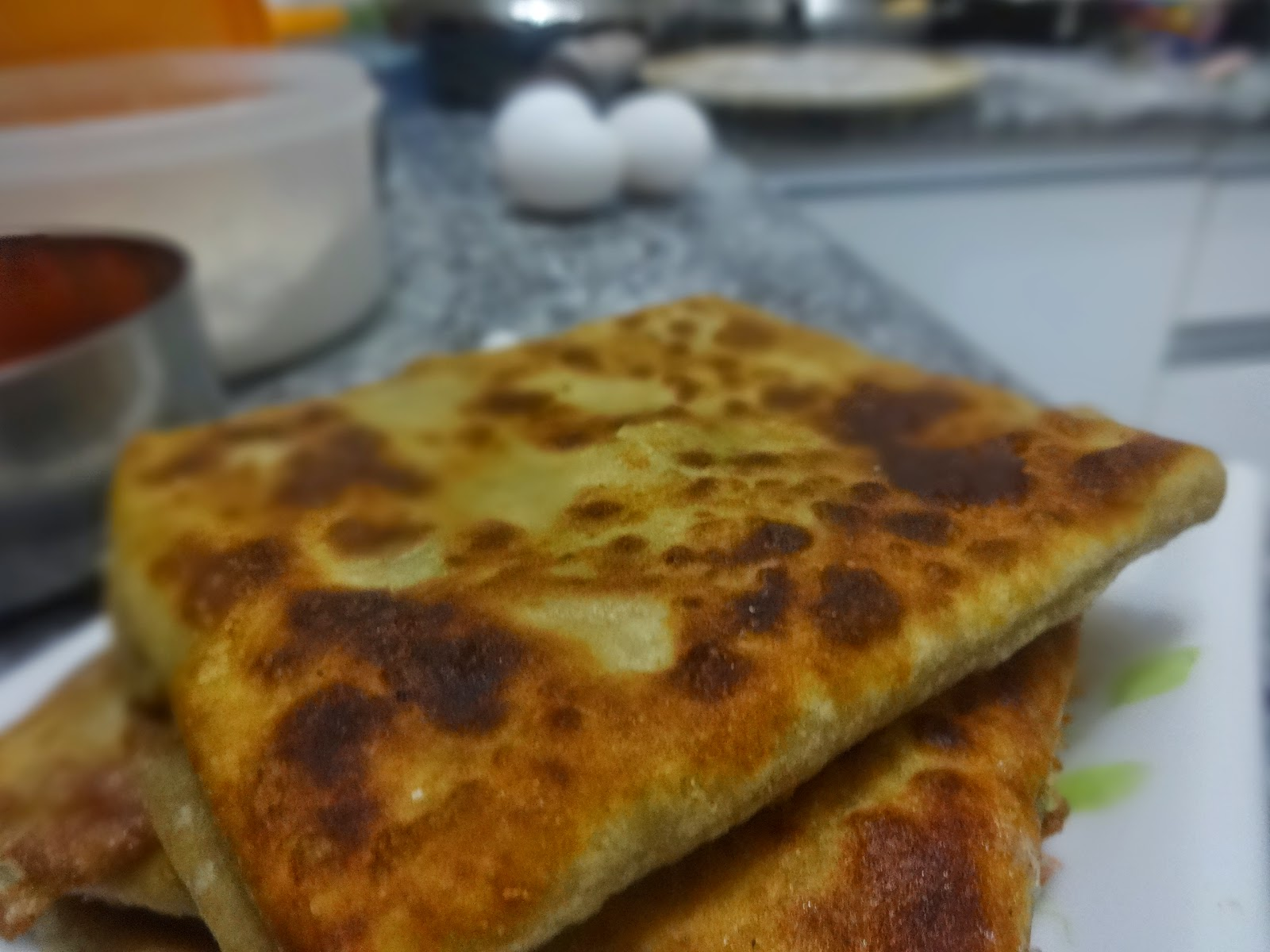 Fish or Chicken Mughlai Paratha( fried  flat bread stuffed with minced chicken/Fish and egg)