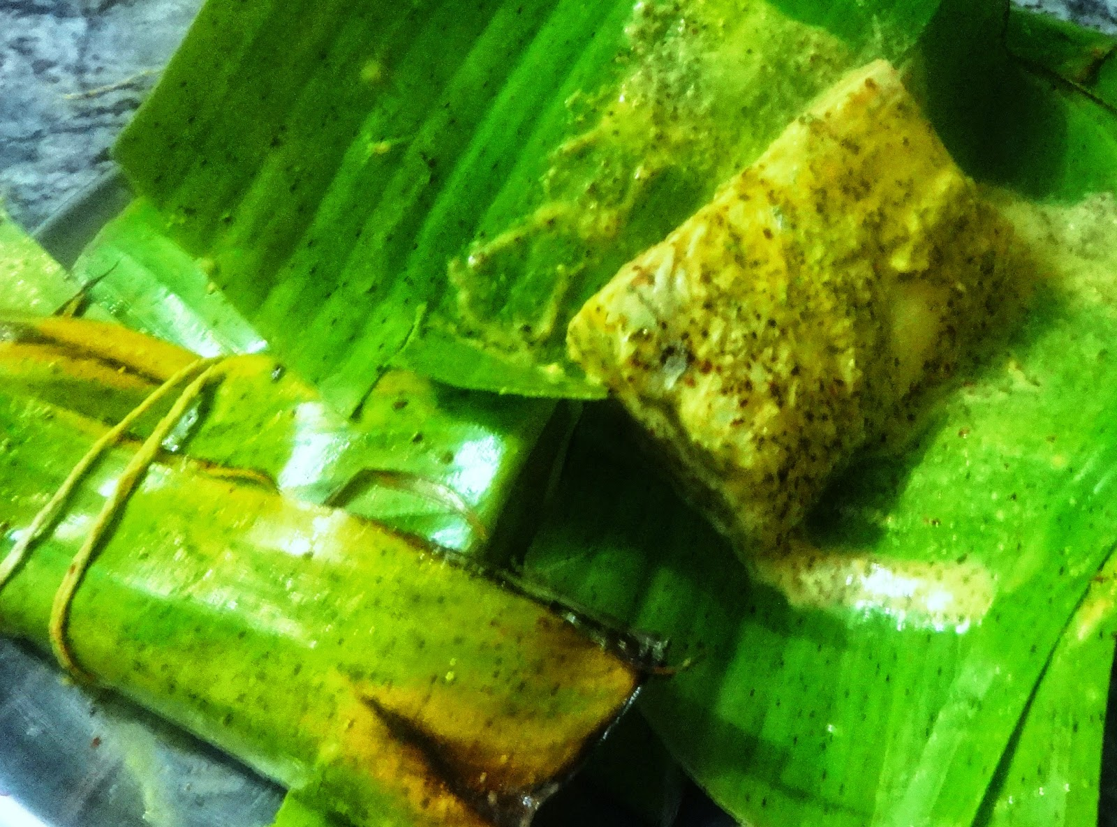 MACHHER PATURI( Fish steamed in Banana leaf with mustard sauce)