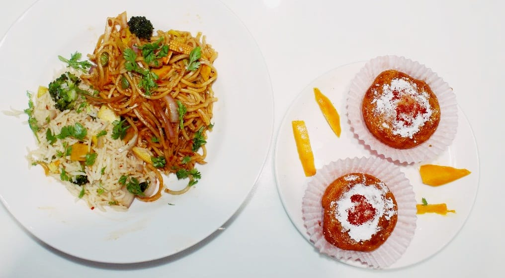 Mango salad with vegetable hakka noodles and mango cupcakes