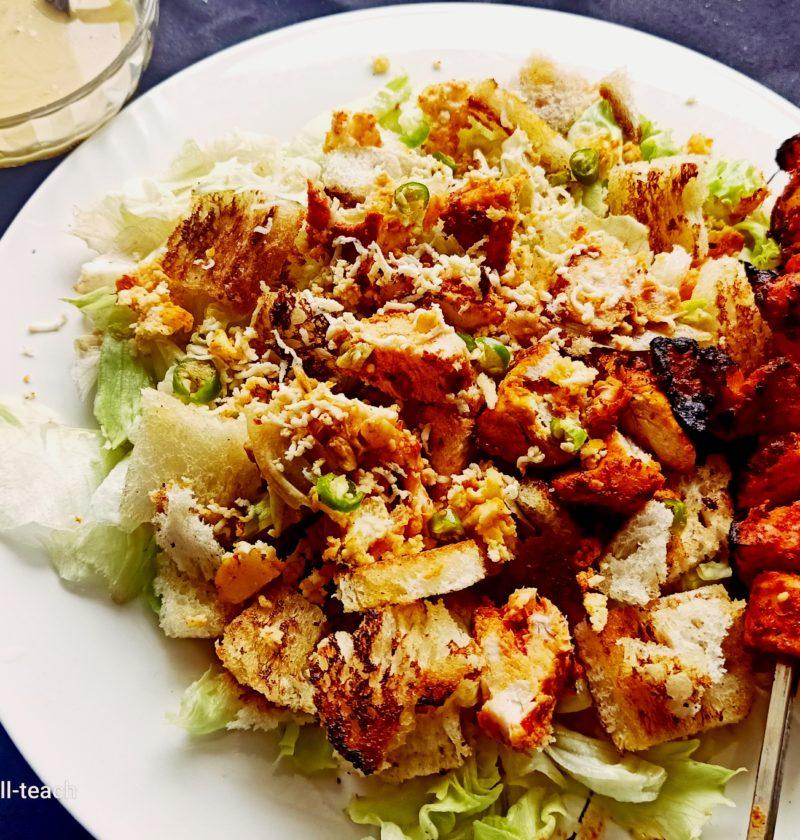 Live cooking Caesar salad